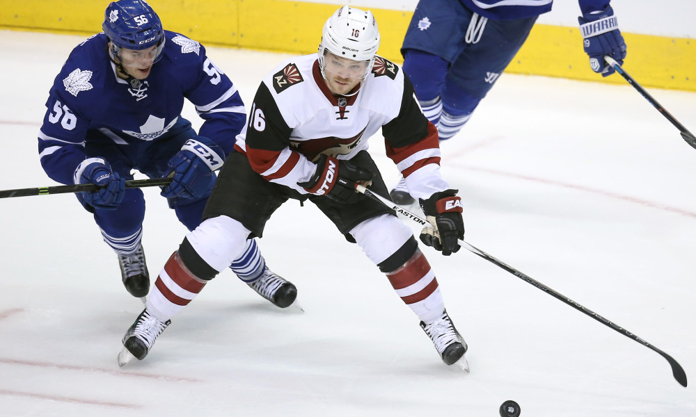 Oct 26, 2015; Toronto, Ontario, CAN; Arizona Coyotes center Max Domi (16) skates with the puck as Toronto Maple Leafs cenetr Byron Froese (56) pressures him at Air Canada Centre. Mandatory Credit: Tom Szczerbowski-USA TODAY Sports ORG XMIT: USATSI-228060 ORIG FILE ID: 20151026_ajw_sx9_051.jpg